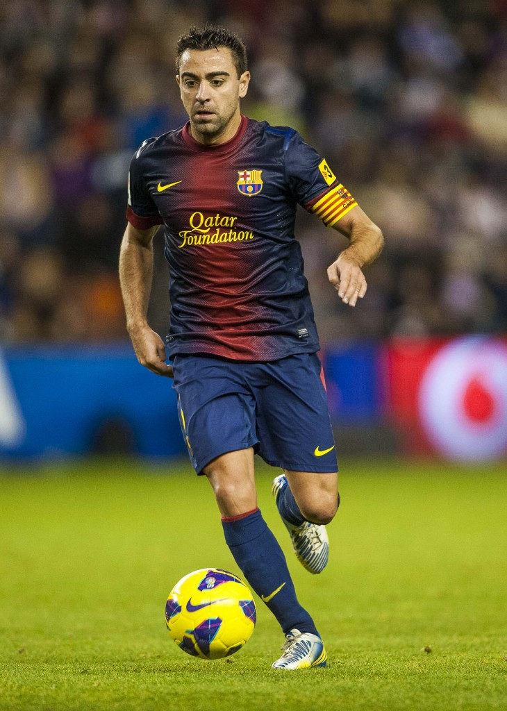 VALLADOLID, SPAIN - DECEMBER 22: Xavi Hernandez of FC Barcelona runs with the ball during the La Liga game between Real Valladolid and FC Barcelona at Jose Zorrilla on December 22, 2012 in Valladolid, Spain. (Photo by Victor Fraile/Getty Images)